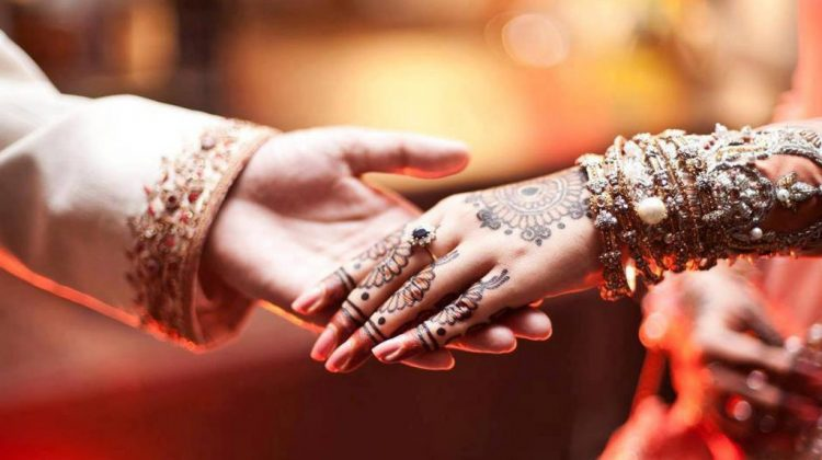 wedding-couple-holding-hands